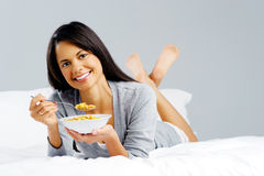 Cereal woman in bed Royalty Free Stock Photos