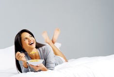 Cereal woman in bed Stock Photography