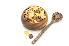 Cereal in wooden blow and wooden spoon on white background Stock Images