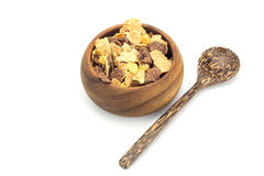 Cereal in wooden blow and wooden spoon on white background Royalty Free Stock Image