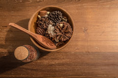 Cereal in a wooden bowl. And a wooden spoon with a clear bottle of rice on a wooden table Royalty Free Stock Image