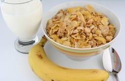 Cereal y plátano de desayuno Foto de archivo
