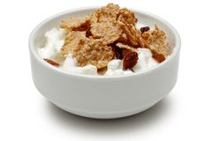 Cereal and yoghurt in bowl on white background. Cereal and yoghurt in bowl isolated on white background stock photo