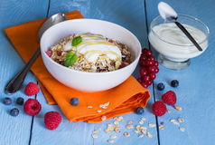 Cereal with yogurt and fruits on wood Stock Photography