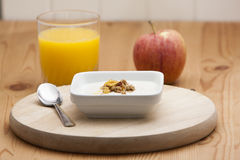 Cereal with yogurt and orange juice with apple Royalty Free Stock Photos