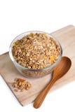 Cereale del Granola con i frutti secchi in ciotola Immagine Stock
