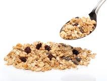 Cereali del Granola su un cucchiaio Fotografia Stock Libera da Diritti