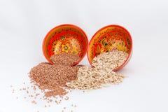 Cereali nei piatti Fotografie Stock Libere da Diritti
