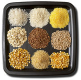 Cereals. Nine sorts of cereals on the black plate macro shot background Royalty Free Stock Image