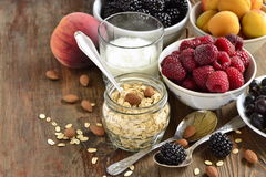 Cereals, almonds and various berries for breakfast Stock Image