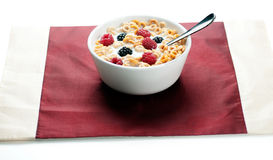Cereals blackberries and milk in bowl 02. A bowl of cereals with fresh blackberries and raspberries with milk in a white background Stock Photos