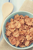 Cereals in blue bowl on white background Royalty Free Stock Image