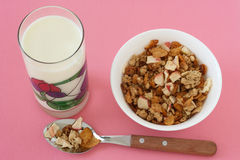 Cereals in a bowl with glass of milk Royalty Free Stock Image