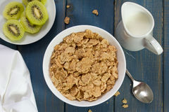 Cereals in bowl with kiwi Stock Images