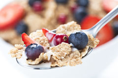 Cereals bowl with red fruits  on white Stock Photo