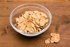 Cereals in bowl on wood Stock Photos