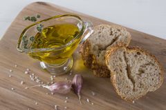 Cereals bread, olive oil with herb spicy, garlic and sea salt. Royalty Free Stock Images