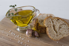 Cereals bread, olive oil with herb spicy, garlic and sea salt. Stock Photo