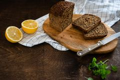 Cereals bread with seeds baked at home, bio ingredients, healthy nutrition. Sliced rye bread on cutting board. copy space stock photos