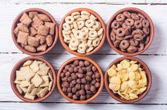 Cereals . Breakfast with milk and chocolate cornflakes. In bowl Stock Photography