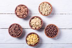 Cereals . Breakfast with milk and chocolate cornflakes. In bowl Royalty Free Stock Photos