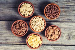 Cereals . Breakfast with milk and chocolate cornflakes. In bowl Royalty Free Stock Image