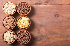 Cereals . Breakfast with milk and chocolate cornflakes. In bowl Stock Photos