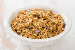 Cereals with chocolate on white bowl Stock Photos