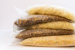 Cereals in cooking bags stock images