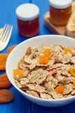 Cereals with dry fruits in bowl and jam Stock Photos