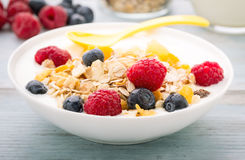 Cereals and falkes with berries Stock Photos