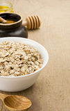Cereals flake in plate and honey Royalty Free Stock Photography