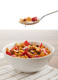 Cereals and fruit with milk in bowl and on spoon Royalty Free Stock Photos