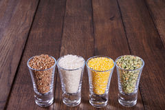 Cereals in a glass on old boards. Background Royalty Free Stock Photo