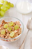 Cereals with grapes on bowl with milk and spoon Royalty Free Stock Image
