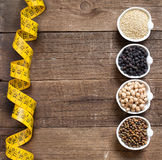 Cereals and legumes in bowls Stock Image