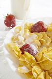 Cereals with milk and strawberries Royalty Free Stock Image
