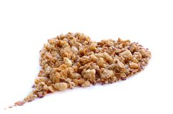 Cereals and muesli, heart shape. Large size photo of a heart made of various cereals and muesli: you may see closely different seeds, cereals, dried berries, etc Stock Images