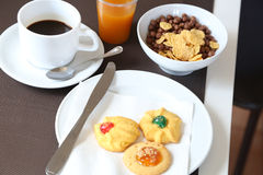 Cereals, pastries, coffee and orange juice for breakfast Stock Photos