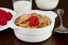 Cereals with raspberries in the bowl Stock Photos