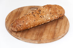Cereals seeds on the sandwich roll Royalty Free Stock Image