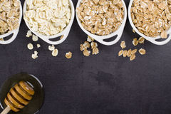 The cereals. Spoon with seeds of almonds flakes, sesame, pumpkin and cranberry. cereals flakes Royalty Free Stock Photography