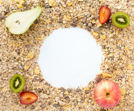 Cereals spread out on Background with fresh Fruits Royalty Free Stock Photo