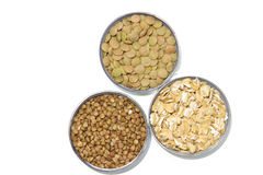 Cereals on a white background. Lentils, buckwheat, oatmeal Royalty Free Stock Image