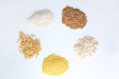 Cereals on a white background. Oatmeal, buckwheat, pasta, Millet Grits and rice on a white background Stock Image
