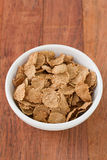 Cereals in white bowl. On table royalty free stock images