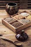 Cereals in a wooden box in rustic style Stock Photos