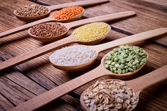 Cereals in wooden spoons Royalty Free Stock Photography