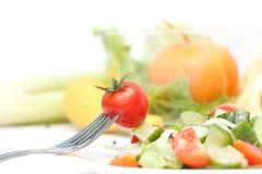 Cereja do tomate em uma forquilha. Dieta Fotos de Stock Royalty Free