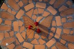 Cereja doce em uma cadeira de jardim Fotos de Stock